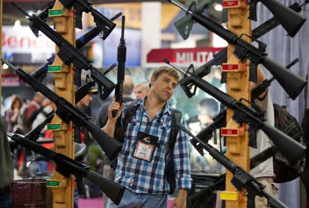 APTOPIX Gun Debate Tradeshow