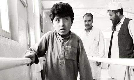 Afghan boy Ataqullah tries prosthetic leg