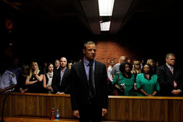 """Blade Runner"" Oscar Pistorius awaits the start of court proceedings in the Pretoria Magistrates court"