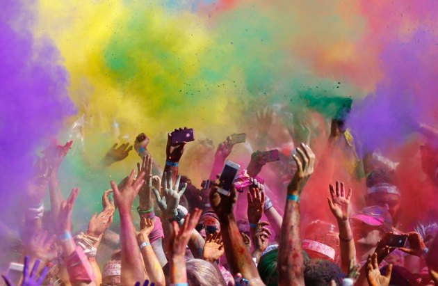 Runners cheer after they finish the Colour Run at Sydney Olympic Park