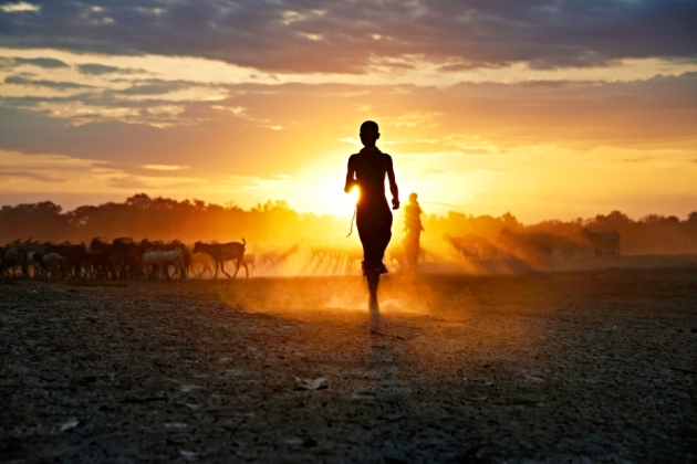 _DSC2712; Kara Tribe, Omo Valley, Ethiopia, 08/2012, ETHIOPIA-10032.  Silhouette of a young girl running into the sunset. Running at Sunset retouched_Sonny Fabbri MAX PRINT SIZE: 40X60