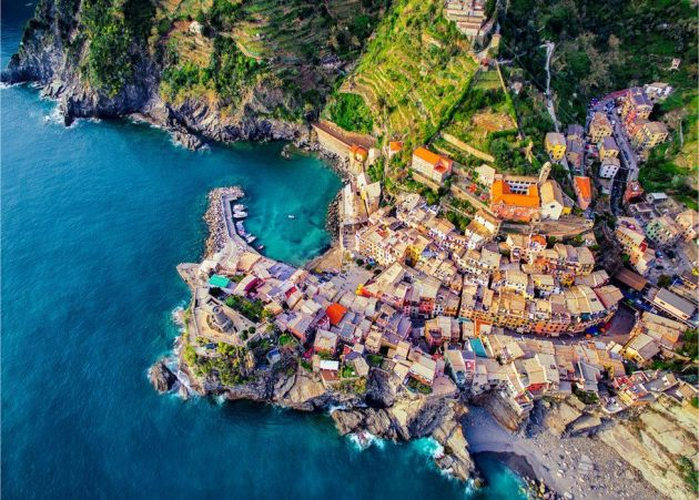 An idyllic view of the brightly-coloured buildings of the Italian seaside town of Vernazza.